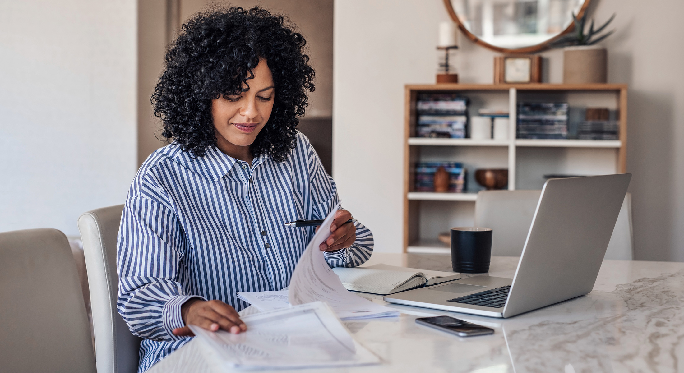 Woman working at home on laptop